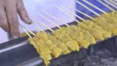 Satay chicken on grill Stock Footage