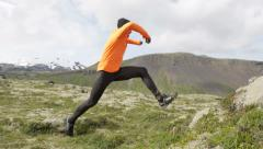 Cross country trail run jumping running man - Fit male runner exercising Stock Footage