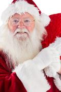 Stock Photo of Jolly Santa carries his sack