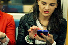 People with smartphone and cellphone in metro train NTSC - stock footage