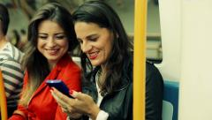 Friends talking over smartphone while riding metro HD Stock Footage