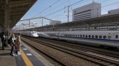 Shinkansen Train Passing Through Himeji Station in Japan Stock Footage