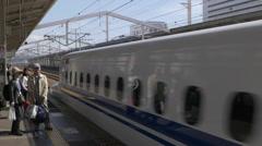 Shinkansen Train Arrives at Himeji Station in Japan Stock Footage