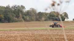 Agricultural scene. Tractors ploughing a field Stock Footage