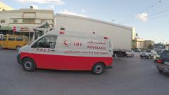 Ambulance of the Palestinian Red Crescent hurries to aid injured Stock Footage