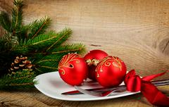 Decorate christmas plate with bauble and pines on wooden surface Stock Photos