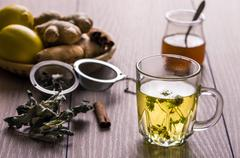still life with tea. natural herbal tea with mentha, honey and lemon. - stock photo