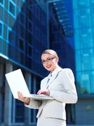 Pretty Young Businesswoman in White Using Laptop Stock Photos