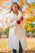 Attractive Model in White Autumn Coat and Gloves Stock Photos