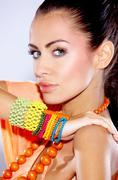 Sensual Young Woman with Assorted Accessories Stock Photos