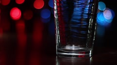 Beer glass filling with beer on a police light/crime background Stock Footage