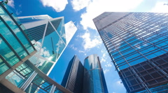 Timelapse video of office buildings with reflection of clouds - stock footage