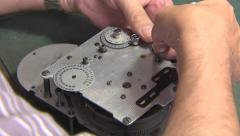 Camera Repair Technician with a 16 mm bolex 4 Stock Footage