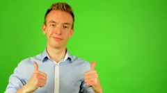 man - green screen - portrait - man agrees (shows thumbs up for approval) - stock footage