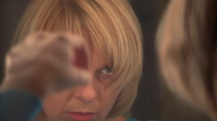 Beautiful woman straightens her hair before a mirror, dolly,slow motion 2 Stock Footage