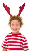 Stock Photo of Cute little boy wearing antlers