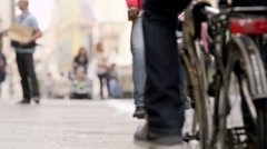 People riding bicycles in the city streets in the afternoon 4K - stock footage