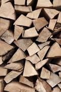 Fire wood stack, textured view of cut pieces Stock Photos