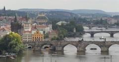 UHD 4K Prague Skyline Aerial View Charles Bridge Famous Landmark Ship Boats Stock Footage