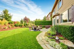 Luxury house exterior with impressive backyard landscape design Stock Photos