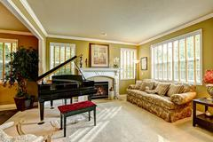 luxury family room with grand piano - stock photo
