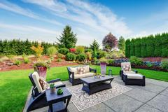 impressive backyard landscape design with patio area - stock photo
