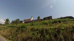 Mukachevo castle Palanok under the clear blue sky on a summer day Stock Footage