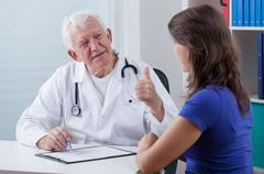 Stock Photo of general practitioner showing thumb up