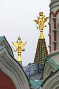 Golden eagles national emblem of russia in the tower peaks Stock Photos