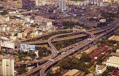Panoramic view to the bangkok and the traffic multilevel crossing Stock Photos