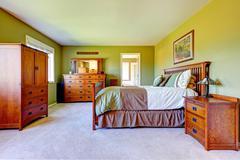 master bedroom interior in bright green color - stock photo