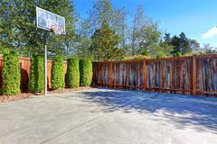 Backyard with basketball court Stock Photos
