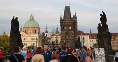 UHD 4K Tourists Visiting Old Town Prague People Crossing Famous Charles Bridge Stock Footage
