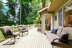 spacious walkout deck with sitting area - stock photo