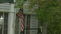 American Flag and white historic home Stock Footage