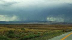 Storm Clouds over Mountains near Nevada Highway I-90 - stock footage