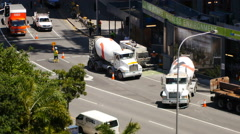 Traffic flow and cement mixers time lapse 4K Stock Footage