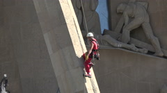Barcelona Sagrada Familia worker climb rope tower 4K 031 Stock Footage
