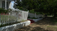 Southern Victorian house and picket fence Stock Footage