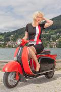 Blonde Model in a summer dress on a scooter - stock photo
