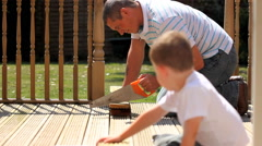 Father and son sawing Stock Footage
