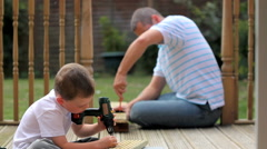 Father teaches son some home improvement skills Stock Footage