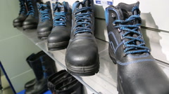 Store work clothes and black boots Stock Footage
