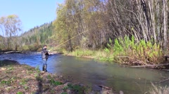 Man is fishing on river Stock Footage