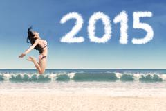 Attractive woman celebrate new year on beach Stock Illustration