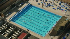 Aerial View Pool with Swimmers - stock footage