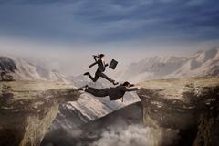 Businesswoman runs through her partner Stock Illustration
