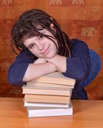 student with books on the table - stock photo