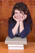 Teenage girl with books on the table Stock Photos