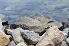 Stock Photo of Granite Boulders Along The Lake Shoreline